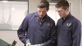 Engineer Teaching Apprentice To Use Grinding Machine Royalty Free Stock Photos