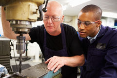 Engineer Teaching Apprentice To Use Milling Machine Royalty Free Stock Image