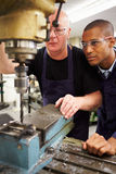Engineer Teaching Apprentice To Use Milling Machine royalty free stock photo