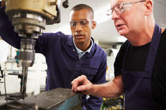 Engineer Teaching Apprentice To Use Milling Machine Royalty Free Stock Photos