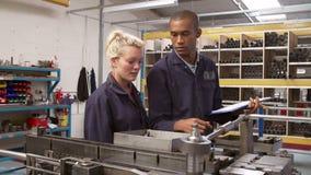 Engineer Teaching Apprentice To Use Tube Bending Machine Stock Photos