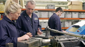 Engineer Teaching Apprentices To Use Tube Bending Machine Royalty Free Stock Image
