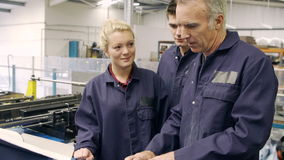 Engineer Teaching Apprentices To Use Tube Bending Machine Stock Images
