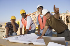 Engineer With Team Of Architects At Site Royalty Free Stock Images