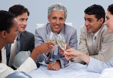 Engineer team celebrating a success with champagne Stock Photo