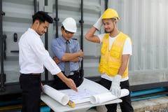 Engineer team look at construction blueprint. Asian senior Engineer manager, 40-50 years old man, look at construction project plan blueprint with field engineer stock photos