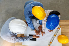 Engineer team looking paper plans at construction site, Top view Royalty Free Stock Photo