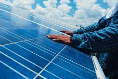 Free Engineer Team Working On Replacement Solar Panel In Solar Power Stock Images - 118384884