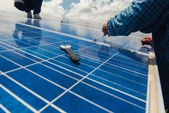 Engineer team working on replacement solar panel in solar power. Plant;engineer and electrician team swapping and install solar panel ; electrician team royalty free stock images