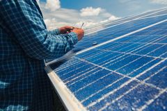Engineer team working on replacement solar panel in solar power. Plant;engineer and electrician team swapping and install solar panel ; electrician team stock image