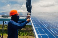 Engineer team working on replacement solar panel in solar power. Plant;engineer and electrician team swapping and install solar panel ; electrician team royalty free stock photography
