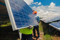 Engineer team working on replacement solar panel in solar power. Plant;engineer and electrician team swapping and install solar panel ; electrician team stock images