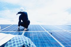 Engineer team working on replacement solar panel in solar power. Plant;engineer and electrician team swapping and install solar panel ; electrician team stock photo