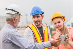 Engineer Teamwork consult together. Looking project at tablet stock images