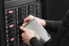 IT Consultant Replace SAN Harddrive Stock Photo