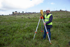 Engineer with theodolite Royalty Free Stock Photos