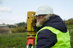 Engineer with theodolite Royalty Free Stock Images