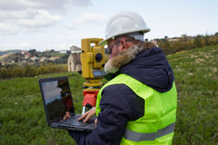 Engineer with theodolite. Engineer in the pipeline controls the project with precision instruments royalty free stock image