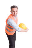 Engineer throwing his yellow helmet Royalty Free Stock Photos