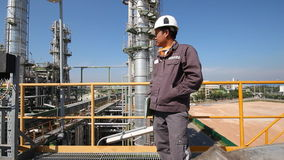 Engineer to worrking in refinery plant stock video