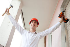 Engineer with a tools in raised hands Stock Images