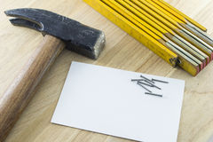 Engineer tools. Some engineer or architect tools with a blanc card on a wood background Stock Photos