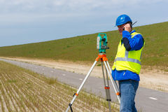 Engineer and Total station or theodolite Stock Image