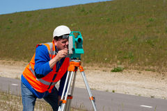 Engineer and Total station or theodolite Stock Images