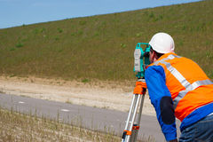 Engineer and Total station or theodolite Stock Photo