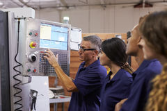 Engineer Training Apprentices On CNC Machine Stock Photography