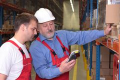 Engineer training employee. A view of a senior engineer training a newly hired employee stock photography