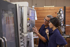 Engineer Training Female Apprentice On CNC Machine Stock Images