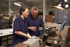 Engineer Training Female Apprentice On Milling Machine stock photo