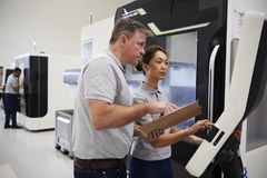 Engineer Training Female Apprentice To Use CNC Machine In Factor. Y stock image