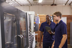 Engineer Training Male Apprentice On CNC Machine stock image