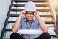 Engineer tried and pressured. Because the construction problem Stock Photos