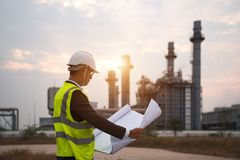 Engineer in uniform and helmet on of background the Construction Site power plant stock images