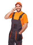 Engineer in uniform with mobile phone Stock Photography