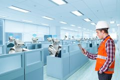 Engineer use digital tablet communication with automatic robot Stock Image