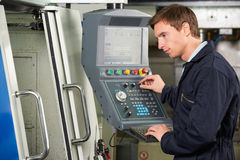 Engineer Using Computer Controlled Cutting Machine Royalty Free Stock Images