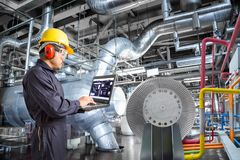 Engineer using computer for maintenance in thermal power plant Royalty Free Stock Images