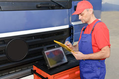 Engineer using diagnostic equipment Royalty Free Stock Image