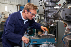 Engineer Using Drill In Factory Stock Images