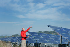 Engineer Using Laptop At Solar Panels Plant Field Stock Photography