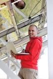 Engineer Using Laptop At Solar Panels Plant Field Stock Image
