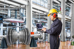 Engineer using laptop computer in the factory.  stock images