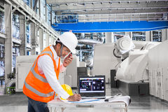 Engineer using laptop computer for maintenance equipment in powerhouse Royalty Free Stock Photos