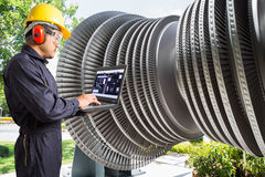 Engineer using laptop computer for maintenance steam turbine Stock Photo