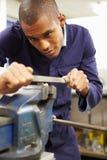 Engineer Using Metal File On Factory Floor Stock Image