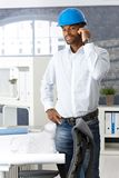 Engineer using mobile in office Royalty Free Stock Photography